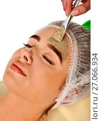Купить «Mud facial mask of woman in spa salon. Face massage .», фото № 27066934, снято 19 марта 2017 г. (c) Gennadiy Poznyakov / Фотобанк Лори