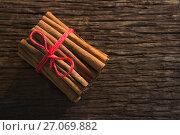 Купить «Cinnamon sticks tied with string», фото № 27069882, снято 5 июня 2017 г. (c) Wavebreak Media / Фотобанк Лори