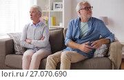 Купить «senior couple having argument at home», видеоролик № 27070690, снято 20 сентября 2017 г. (c) Syda Productions / Фотобанк Лори