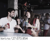 Купить «Couple talking in nightclub», фото № 27073854, снято 28 августа 2017 г. (c) Яков Филимонов / Фотобанк Лори