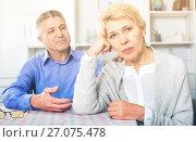 Купить «Mature couple decide family matters and find out relationship», фото № 27075478, снято 18 января 2019 г. (c) Яков Филимонов / Фотобанк Лори