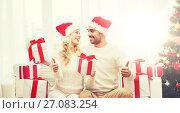 Купить «happy couple with christmas gifts and thumbs up», фото № 27083254, снято 8 октября 2015 г. (c) Syda Productions / Фотобанк Лори