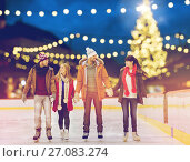Купить «happy friends at christmas skating rink», фото № 27083274, снято 26 ноября 2014 г. (c) Syda Productions / Фотобанк Лори
