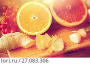 Купить «citrus, ginger, garlic and rowanberry on wood», фото № 27083306, снято 13 октября 2016 г. (c) Syda Productions / Фотобанк Лори
