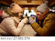 Купить «happy young couple with coffee at christmas market», фото № 27083374, снято 2 декабря 2016 г. (c) Syda Productions / Фотобанк Лори