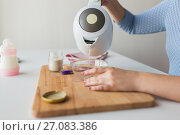 Купить «mother pouring water into bowl for baby cereal», фото № 27083386, снято 21 февраля 2017 г. (c) Syda Productions / Фотобанк Лори