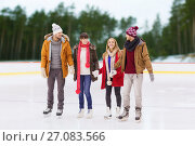 friends holding hands on outdoor skating rink. Стоковое фото, фотограф Syda Productions / Фотобанк Лори