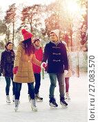 Купить «happy friends ice skating on rink outdoors», фото № 27083570, снято 22 декабря 2014 г. (c) Syda Productions / Фотобанк Лори