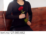 Купить «close up of woman with roses at funeral in church», фото № 27083662, снято 20 марта 2017 г. (c) Syda Productions / Фотобанк Лори