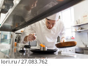 Купить «happy male chef cooking food at restaurant kitchen», фото № 27083762, снято 2 апреля 2017 г. (c) Syda Productions / Фотобанк Лори