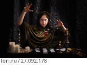 Young woman with divination cards in room. Стоковое фото, фотограф Майя Крученкова / Фотобанк Лори