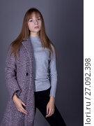 Portrait of a teenage girl in a youth style on a gray background. Стоковое фото, фотограф Вячеслав Чернявский / Фотобанк Лори
