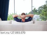Купить «Portrait of young man with hands behind his head is relaxing on couch», фото № 27093070, снято 25 августа 2019 г. (c) Дмитрий Эрслер / Фотобанк Лори
