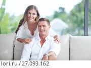Купить «Portrait of nice young couple in summer house environment», фото № 27093162, снято 25 августа 2019 г. (c) Дмитрий Эрслер / Фотобанк Лори