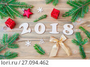 New Year 2018 background with 2018 figures,Christmas toys, fir branches-New Year 2018 holiday still life, фото № 27094462, снято 29 ноября 2016 г. (c) Зезелина Марина / Фотобанк Лори