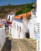 Купить «Cozy narrow paved streets with white houses inside the old city walls of Mertola. Beja. Portugal», фото № 27094610, снято 30 июня 2016 г. (c) Serg Zastavkin / Фотобанк Лори