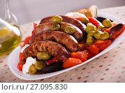 Купить «Grilled sausages and vegetables», фото № 27095830, снято 27 мая 2019 г. (c) Яков Филимонов / Фотобанк Лори