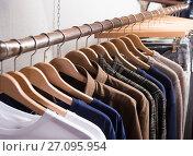Купить «different colored clothes in the modern shop», фото № 27095954, снято 22 августа 2017 г. (c) Яков Филимонов / Фотобанк Лори