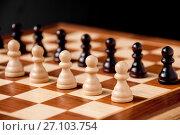 Купить «Still life on the chessboard: white and black pawns stand in a row», фото № 27103754, снято 5 октября 2017 г. (c) Катерина Белякина / Фотобанк Лори