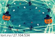 Купить «Halloween background. Spider web, spiders and smiling jack decorations as symbols of Halloween. Halloween concept», фото № 27104534, снято 18 октября 2017 г. (c) Зезелина Марина / Фотобанк Лори