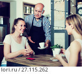 young and cheerful people spending time in cafe. Стоковое фото, фотограф Яков Филимонов / Фотобанк Лори