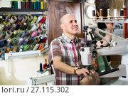 Купить «specialist stitching shoes», фото № 27115302, снято 22 ноября 2019 г. (c) Яков Филимонов / Фотобанк Лори