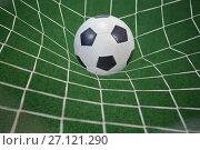 Купить «Football in goalpost against artificial grass», фото № 27121290, снято 22 мая 2017 г. (c) Wavebreak Media / Фотобанк Лори