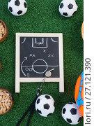 Купить «Strategy board, whistle and football on artificial grass», фото № 27121390, снято 22 мая 2017 г. (c) Wavebreak Media / Фотобанк Лори