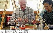 Купить «Artists working together at table 4k», видеоролик № 27123178, снято 23 апреля 2019 г. (c) Wavebreak Media / Фотобанк Лори