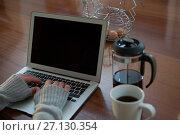 Купить «Woman using laptop in kitchen», фото № 27130354, снято 10 августа 2017 г. (c) Wavebreak Media / Фотобанк Лори