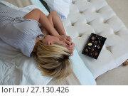 Woman sleeping peacefully on bed. Стоковое фото, агентство Wavebreak Media / Фотобанк Лори