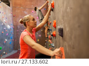 Купить «man and woman exercising at indoor climbing gym», фото № 27133602, снято 2 марта 2017 г. (c) Syda Productions / Фотобанк Лори