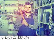 Купить «Master works with a hammer», фото № 27133746, снято 15 марта 2017 г. (c) Яков Филимонов / Фотобанк Лори