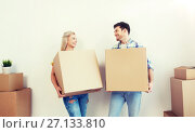 Купить «smiling couple with big boxes moving to new home», фото № 27133810, снято 25 февраля 2016 г. (c) Syda Productions / Фотобанк Лори
