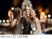 Купить «happy young women with sparklers at new year night», фото № 27133942, снято 21 ноября 2015 г. (c) Syda Productions / Фотобанк Лори