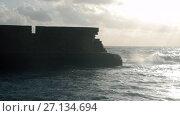 Купить «Ancient stone wall and wavy sea. Acre, Israel», видеоролик № 27134694, снято 22 июля 2019 г. (c) Данил Руденко / Фотобанк Лори