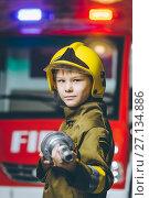 Купить «Child Firefighter play», фото № 27134886, снято 22 октября 2017 г. (c) Mark Agnor / Фотобанк Лори