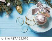 Купить «Christmas decoration on blue wooden background», фото № 27135010, снято 17 октября 2017 г. (c) Майя Крученкова / Фотобанк Лори