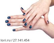 Купить «Female hands with blue Christmas fir-cone and shiny nails manicure isolated on white», фото № 27141454, снято 9 сентября 2017 г. (c) Serg Zastavkin / Фотобанк Лори