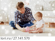 Купить «happy father with baby and piggy bank at home», фото № 27141570, снято 12 июля 2016 г. (c) Syda Productions / Фотобанк Лори