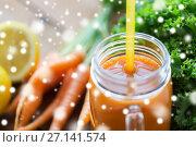 Купить «close up of glass jug or mug with carrot juice», фото № 27141574, снято 5 августа 2016 г. (c) Syda Productions / Фотобанк Лори