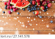 Купить «close up of fruits and berries on wooden table», фото № 27141578, снято 5 августа 2016 г. (c) Syda Productions / Фотобанк Лори