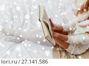 Купить «close up of young woman reading book at home», фото № 27141586, снято 15 октября 2016 г. (c) Syda Productions / Фотобанк Лори