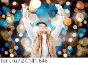 Купить «happy girl in winter earmuffs over holidays lights», фото № 27141646, снято 25 августа 2013 г. (c) Syda Productions / Фотобанк Лори