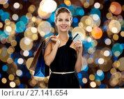 Купить «woman with credit card and shopping bags», фото № 27141654, снято 1 июня 2014 г. (c) Syda Productions / Фотобанк Лори
