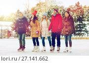 Купить «happy friends ice skating on rink outdoors», фото № 27141662, снято 22 декабря 2014 г. (c) Syda Productions / Фотобанк Лори