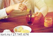 Купить «close up of woman adding ginger to tea with lemon», фото № 27141674, снято 13 октября 2016 г. (c) Syda Productions / Фотобанк Лори