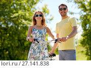 Купить «happy couple with bicycle at country», фото № 27141838, снято 23 июля 2017 г. (c) Syda Productions / Фотобанк Лори