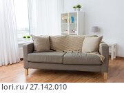 Купить «sofa with cushions at cozy home living room», фото № 27142010, снято 9 сентября 2017 г. (c) Syda Productions / Фотобанк Лори