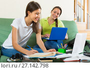 Two female students studying at home. Стоковое фото, фотограф Яков Филимонов / Фотобанк Лори